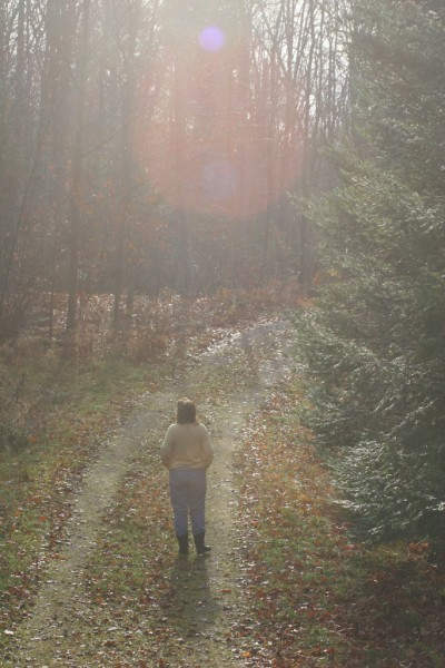 Woman walking on country road in the fall
