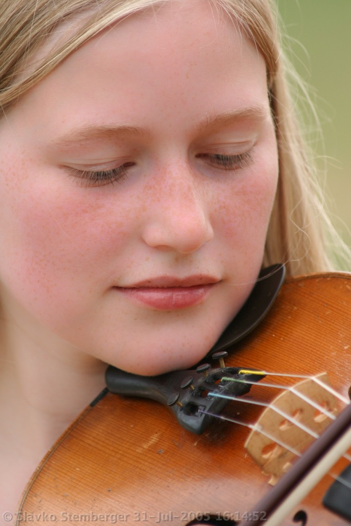 Blond female playing violin